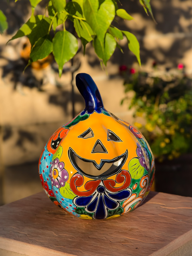 Talavera pumpkin soaking up the sun. Halloween - Tucson style.